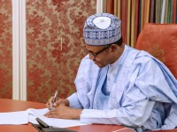 Buhari signs June 12 bill