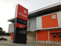 30TH GUARANTY TRUST BANK AGM:  MGT APPROVES ATTENDANCE BY PROXY